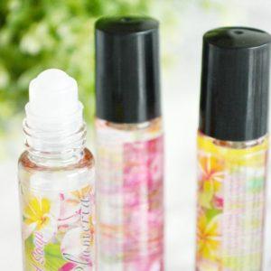 Rosa parfyme med bær og plumeria duft