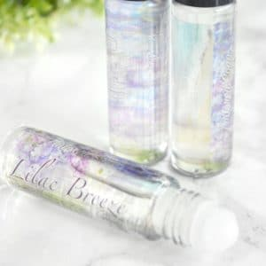 Teal og lilla parfyme med syrinbris duft