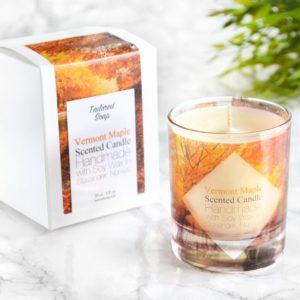 Oransje duftlys med duft av lønnesirup